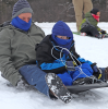Brasher-sledding-man-and-boy.png