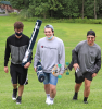 Canton-SUNY-students-walking-with-rugs-2.png