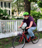 Canton-man-biking-near-fence.png