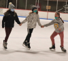 Canton-skating-girls-holding-hands.png