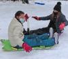 Canton-sledding-2-girls-together.png
