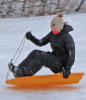 Canton-sledding-girl-in-air.png