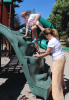 Massena-Springs-Park-playground-Mom-and-boy-climbing.png