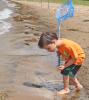 Massena-beach-boy-with-net-2.png