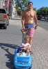 Massena-man-with-son-in-wagon.png