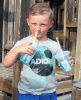 Oburg-playground-boy-drinking-2-cups.png