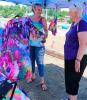 Ogdensburg-Farmers'-Crafts-and-Art-Market-tie-dye-Hillary-Skelly.png