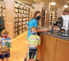 Potsdam-library-checking-out-books-1.png