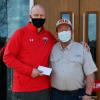 SLU-men's-hockey-donation.png